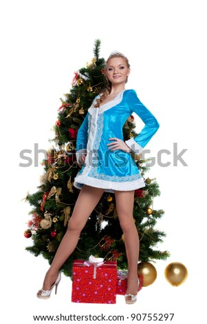 Young Snow Maiden stand with new year fir tree - stock photo