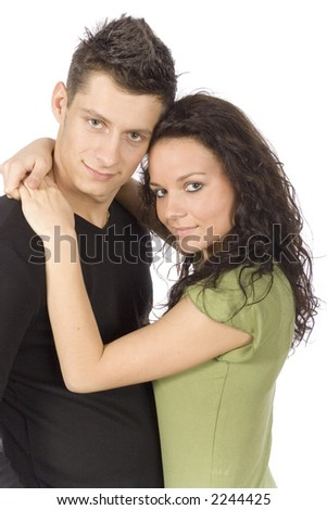 young snuggling couple on the white background - stock photo