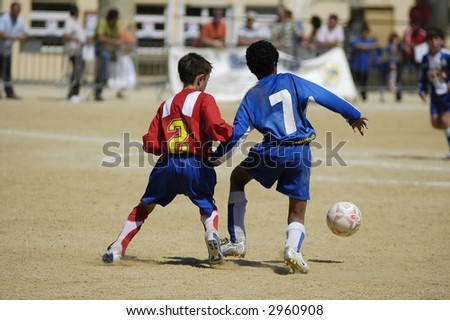 young soccer football players fighting for the ball - stock photo