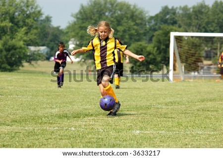 Young Soccer Play Prepare to Kick - stock photo