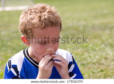 Young soccer player enjoying halftime snack - stock photo