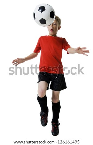Young soccer player holding ball - stock photo