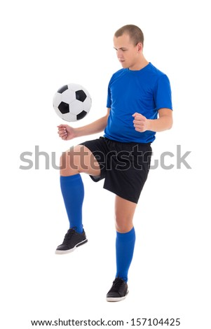 young soccer player in blue uniform playing with ball isolated on white background - stock photo