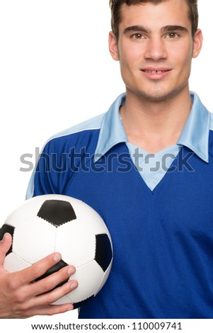 Young soccer player with ball in front of white background - stock photo