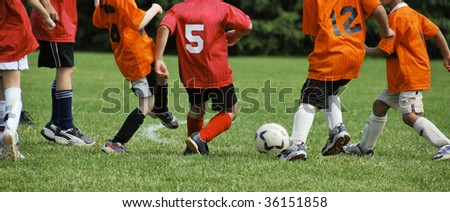 Young soccer players during friendly game - stock photo