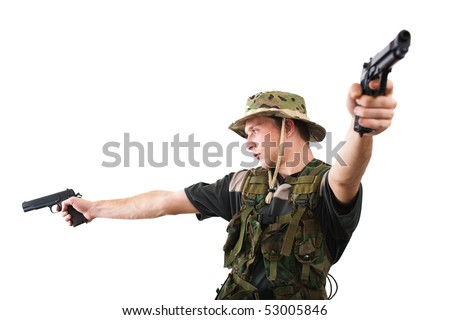 Young soldier in camouflage pointing guns in combat.