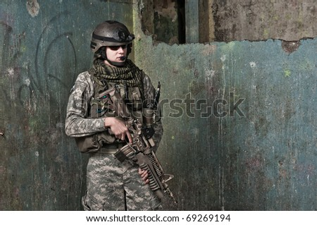 Young soldier on patrol, resting - stock photo