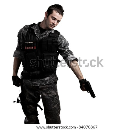young soldier pointing to the ground on a white background - stock photo