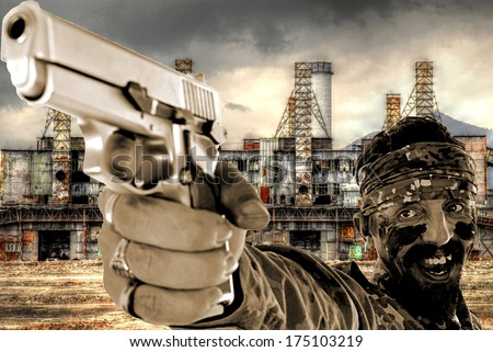 young soldier shooting with a pistol  - stock photo