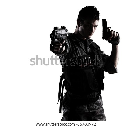 young soldier shooting with a pistol on a white background - stock photo