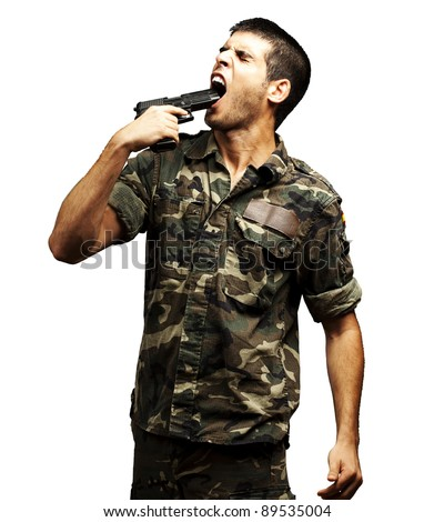 young soldier wearing a jungle camouflage committing suicide against a white background - stock photo