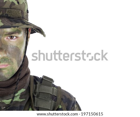 Young soldier with jungle camouflage paint. Isolated on white background - stock photo