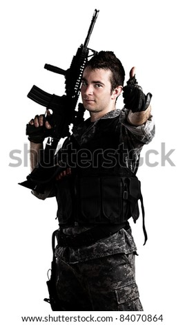 young soldier with urban camouflage on a white background - stock photo