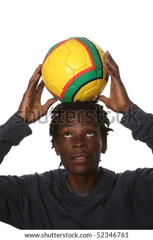 Young South African man with soccer ball on his head - stock photo