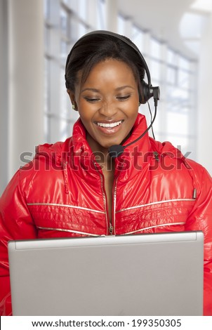 Young  South African woman on internet voice chat helping a customer.  - stock photo