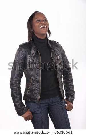 Young South African woman with a gregarious expression on white background. - stock photo