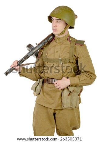 young Soviet soldier with machine gun on the white background