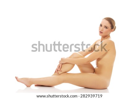 Young spa woman sitting on the floor.