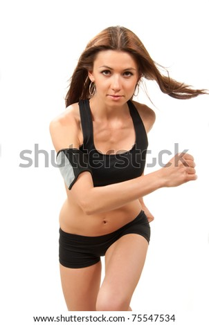 Young sport athletic woman running, jogging isolated on a white background