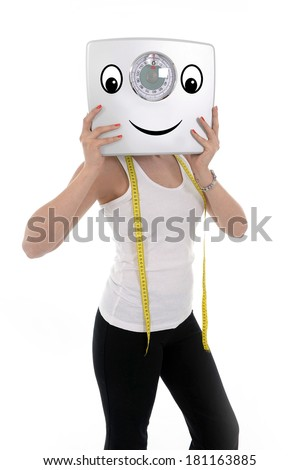 young sport dieting woman holding bathroom weight painted as happy face wearing sport clothes and measure tape in successful diet, weigh loss and healthy fit body concept isolated on white background - stock photo