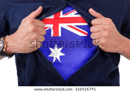 Young sport fan opening his shirt and showing the flag his country Australia - Australian flag - stock photo