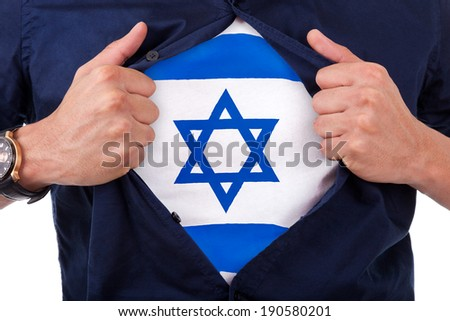 Young sport fan opening his shirt and showing the flag his country Israel, Israeli flag - stock photo