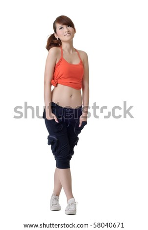 Young sport girl standing and looking copyspace, full length portrait of Asian woman isolated on white background. - stock photo