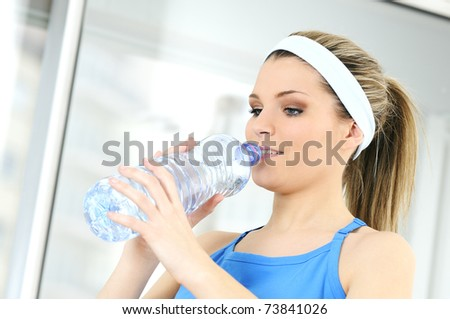 young sportive adult is drinking fresh water - stock photo