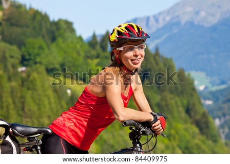 young sportive female biker outdors on her mountain bike - stock photo