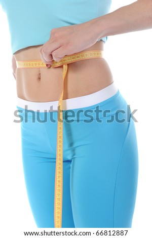 Young sports girl measuring waist. Isolated on white background - stock photo
