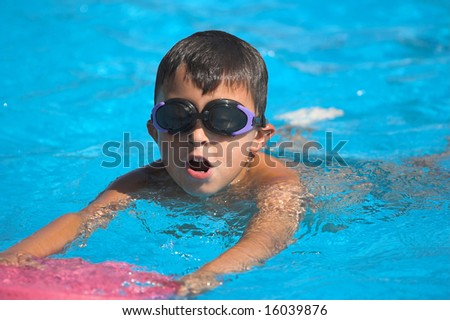 Young sportsman swimming in pool