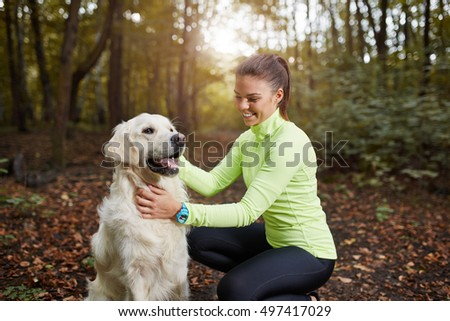 Young sportswoman and her dog