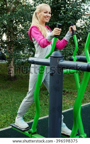 young sporty blond woman outdoor, summer time - stock photo
