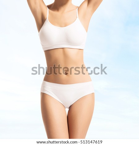 Young, sporty, fit and beautiful girl over sky background.