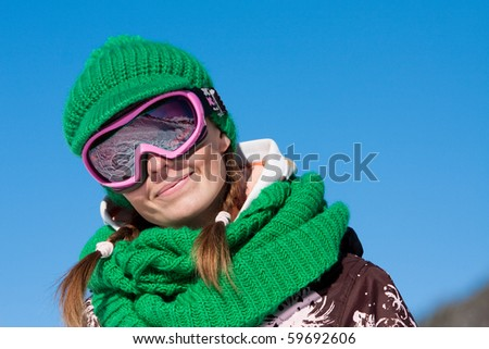 Young sporty girl wearing ski mask and hat. Winter vacation in Alps - stock photo