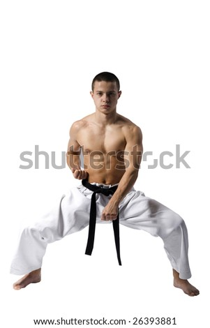 Young Sporty Karate Man Doing Special Exercise Isolated on White Background - stock photo