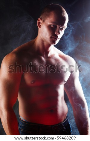 young sporty man over Smoke.