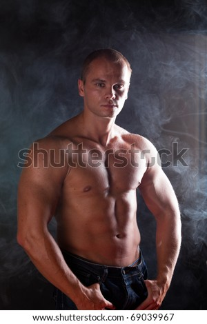 young sporty man over Smoke. - stock photo