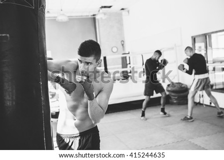Young sporty men in the gym. Male boxer. Training. Mood, break, motivation, coach - sport concept. - stock photo