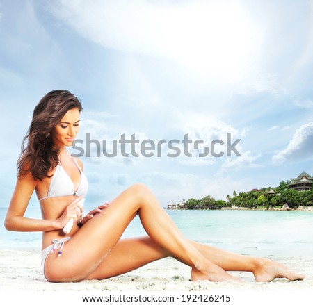 Young, sporty, sexy and beautiful girl in swimsuit resting on exotic beach in summer - stock photo