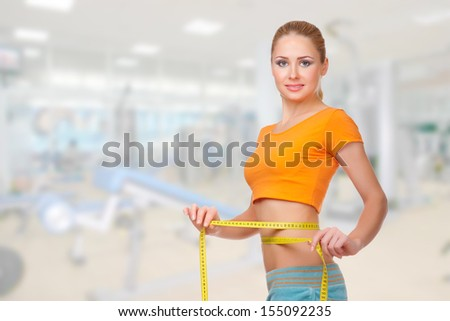 Young sporty smiling woman on health club - stock photo