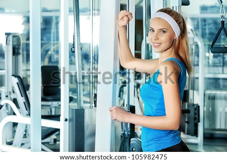 Young sporty woman doing exercises in the gym centre. - stock photo