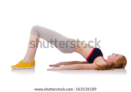 Young sporty woman doing exercises on white - stock photo