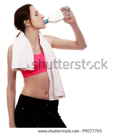 young sporty woman drinking water on white background