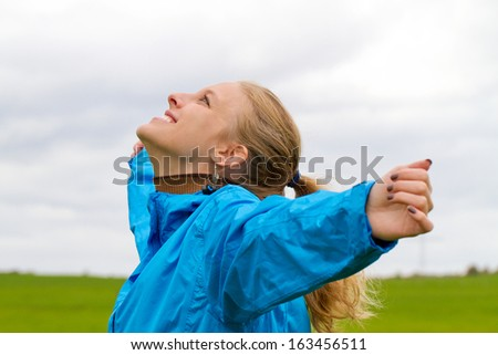 Young, sporty woman enjoy the day - stock photo
