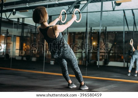 young sporty woman in gym