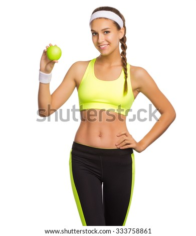 Young sporty woman with apple isolated on white - stock photo