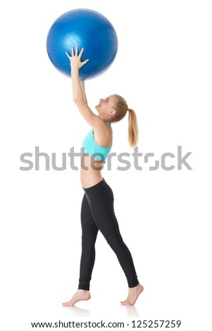 Young sporty woman with gymnastic ball on a white background.