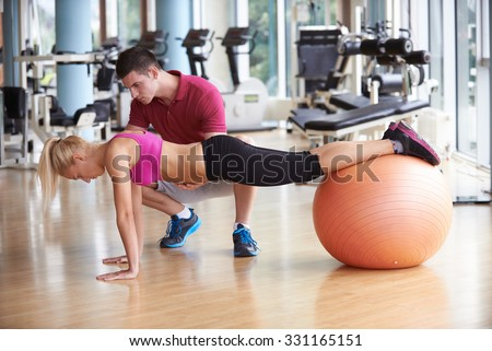 young sporty woman with trainer exercise in fitness gym - stock photo