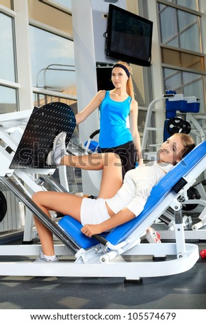 Young sporty women doing exercises in the gym centre.